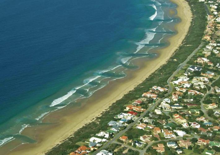 An aerial picture showing rip cureents along the beach in Wilderness