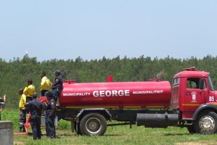 George Fire Truck waiting to refill bomber - raw water used.